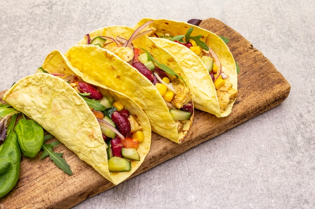 Mexican taco with chicken meat, red bean and fresh vegetables