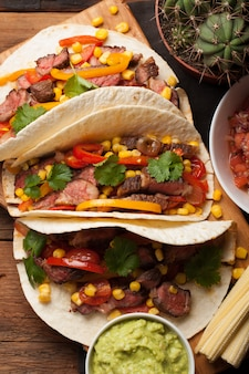 Mexican tacos with marbled beef and vegetables.