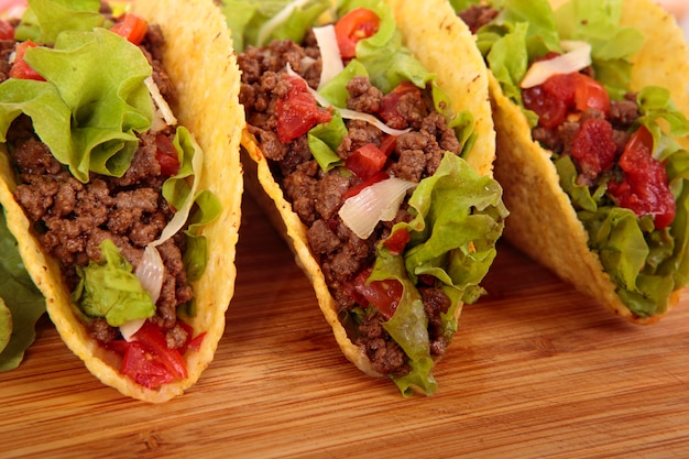 Mexican tacos on wooden table