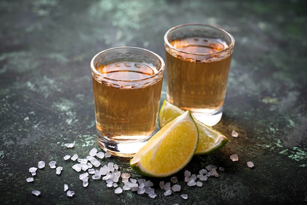 Mexican tequila with salt and limes. selective focus