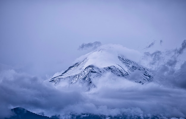 Mexican volcano covered with clouds and snow