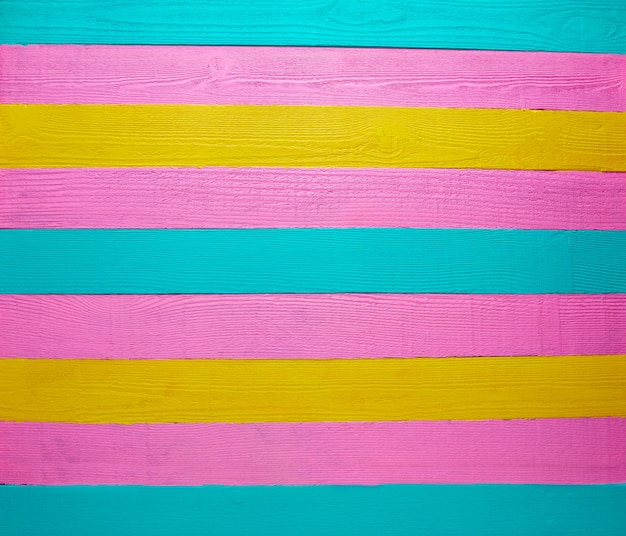 Mexican wood background green pink yellow