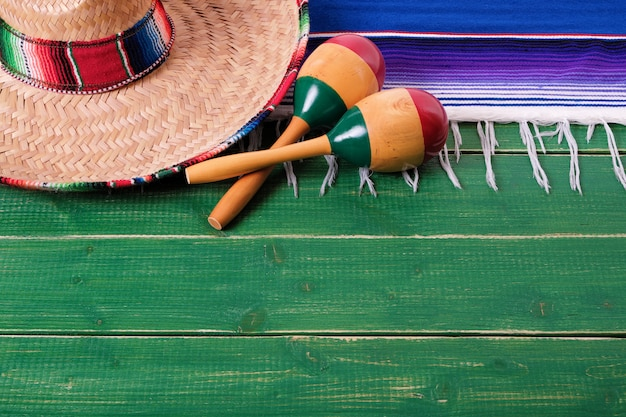 Mexico cinco de mayo wood background mexican sombrero maracas