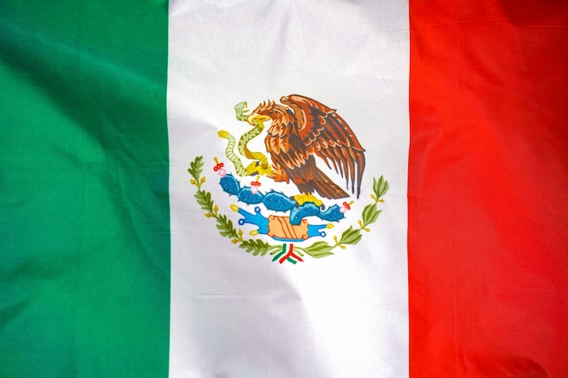 Mexico flag is depicted on a sports cloth fabric with many folds