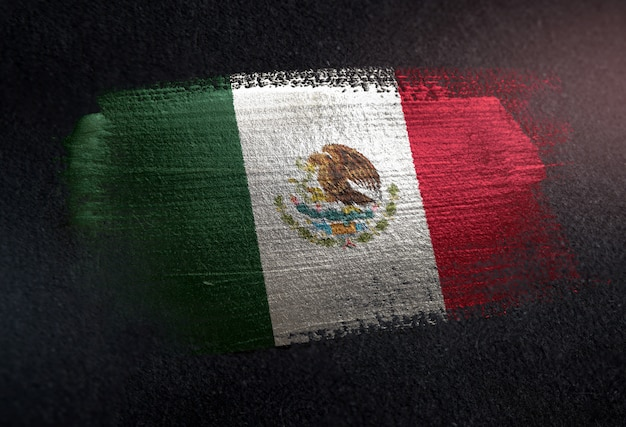 Mexico flag made of metallic brush paint on grunge dark wall