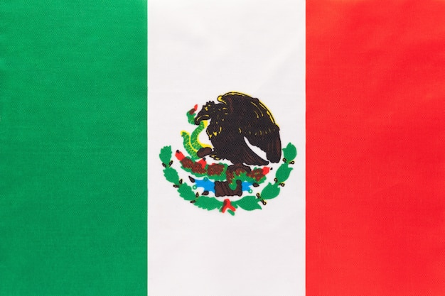 Mexico national fabric flag with emblem, textile background,