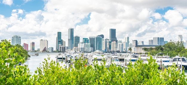 Miami downtown skyline in daytime with biscayne bay and yachts
