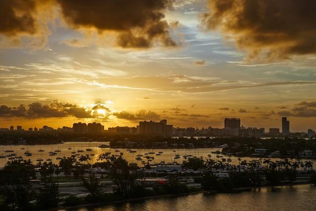 Miami florida at sunset, colorful skyline of illuminated buildings.