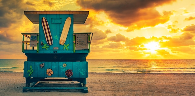 Miami south beach sunrise with lifeguard tower, usa.