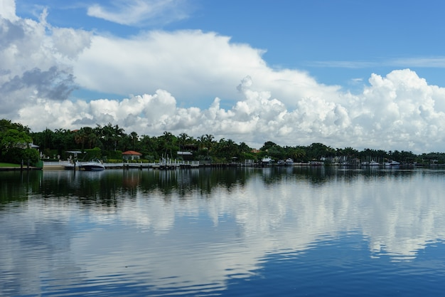 Miami. southern beach. view of beautiful cottages across the river with beautiful clouds and reflection in the water