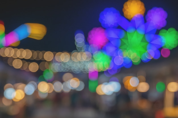 Miaohui or local temple fair lights bokeh abstract background - night time city with colorful light abstract bokeh in city colorful beautiful in night time