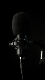 Mic and headphones surrounded by acoustic isolation foam premium photo