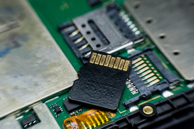 Micro sd card slot inside electronic circuit board smart phone. disassembled cell phone parts.