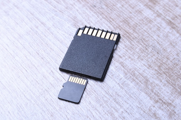 Micro sd memory card adapter on the wooden table. close up