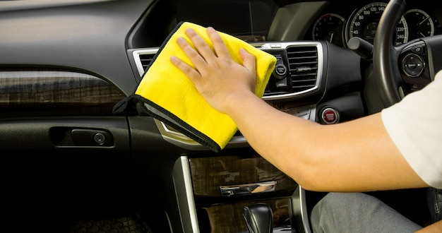 Microfiber and leather console car, hand cleaning interior modern car, microfiber and cleaning solution to clean