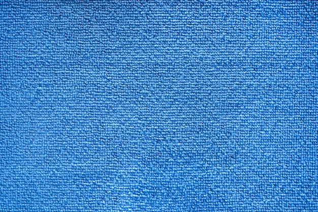 Microfiber towel blue terry texture swatch. fabric texture background. cleaning service. macro