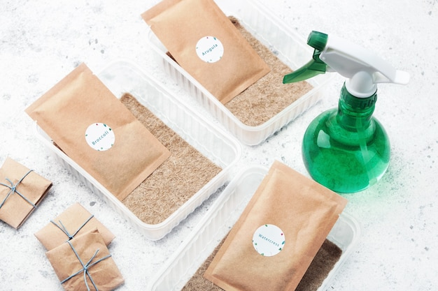 Microgreen planting kits. packs of seeds, plastic containers, sprayer and linen mats.