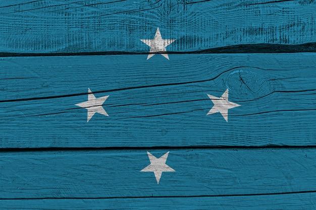 Micronesia flag painted on old wood plank
