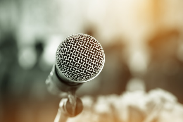 Microphone on abstract blurred background