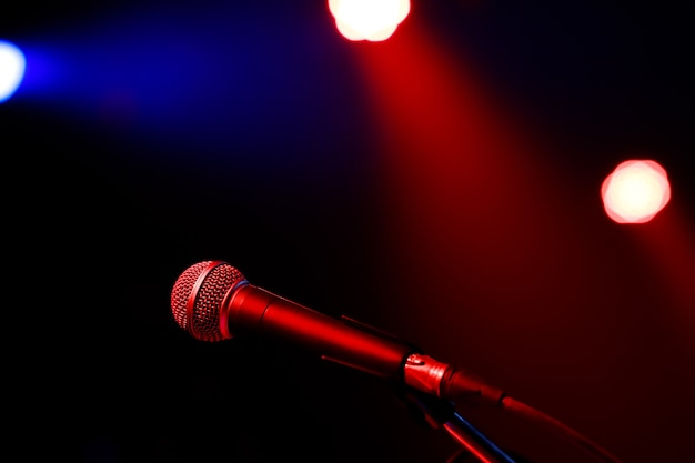 Microphone on abstract blurred of speech in seminar room