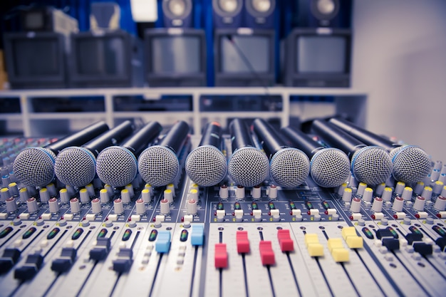Microphone and audio mixer in studio.