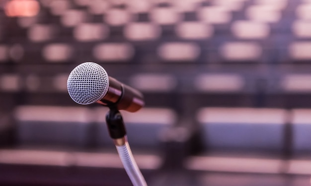 Microphone over the blurred business forum meeting or conference training learning room