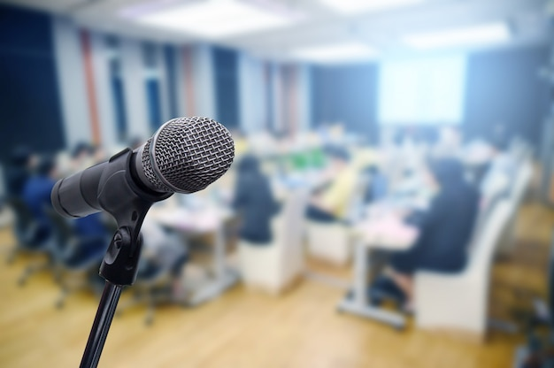 Microphone over the blurred business forum meeting or conference