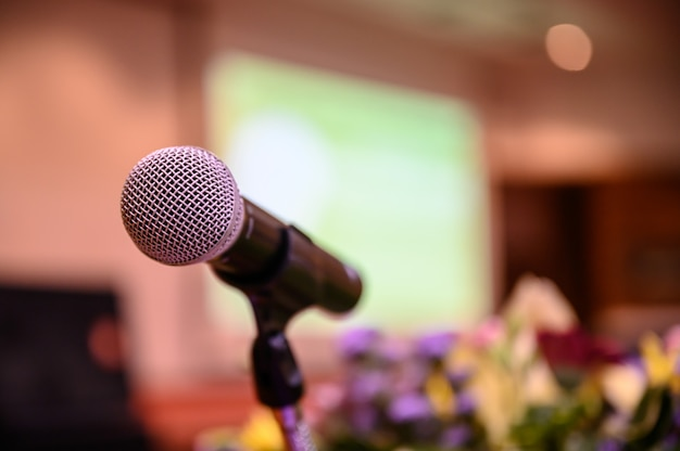 Microphone over the blurred business forum