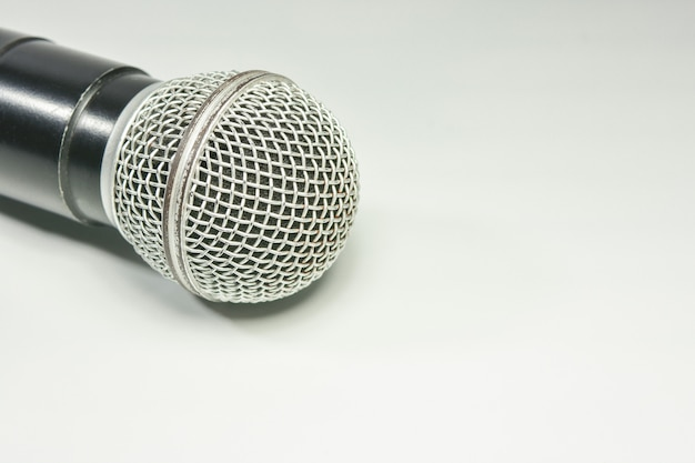 Microphone on the book with white background. call center service operator empty working place.