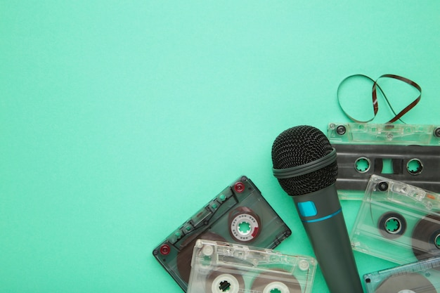 Microphone and cassette on mint with copy space
