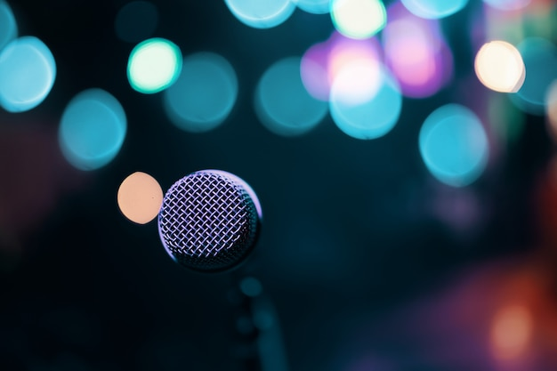 Microphone on colorful background.