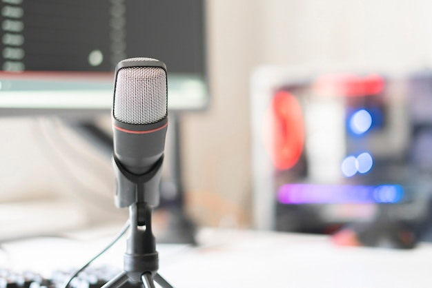 The microphone and computer in the radio studio, recording speach live