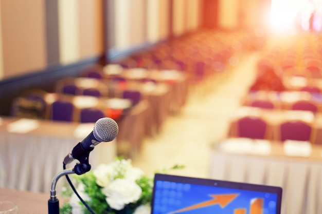 Microphone in the  conference hall or seminar room background.