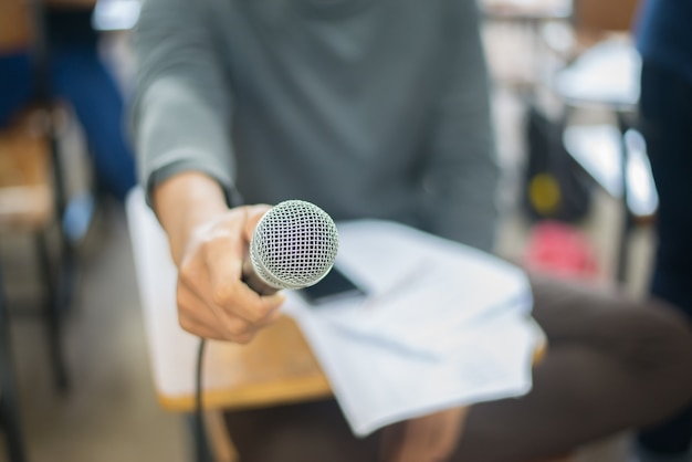 Microphone in a hand of a man