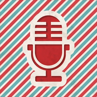 Microphone icon on red and blue striped background. vintage concept in flat design.