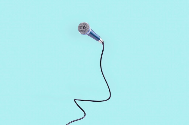Microphone levitating in the air, the concept of accessories for singing