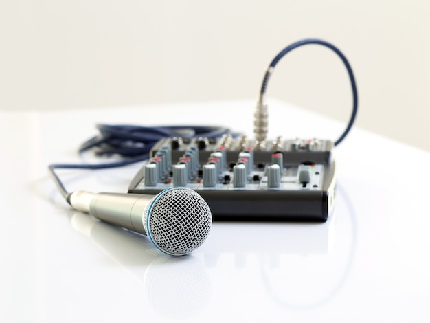 Microphone and mixer on white table