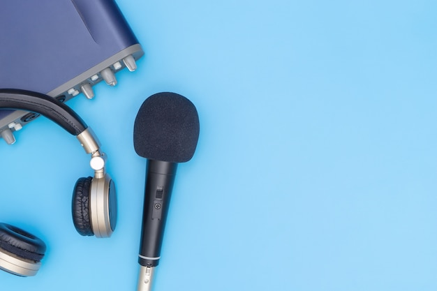 Microphone and music interface headphone on blue