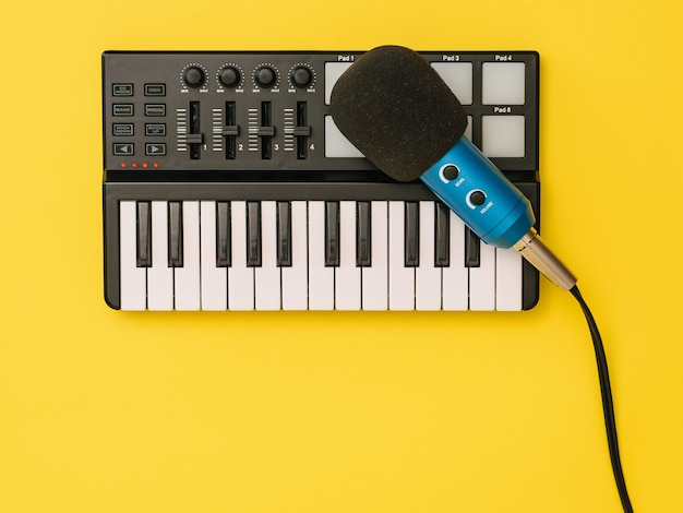 The microphone for music mixer on a yellow background. the concept of workplace organization. equipment for recording, communication and listening to music.