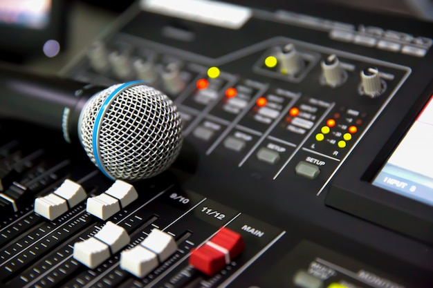 Microphone place on the digital sound mixer