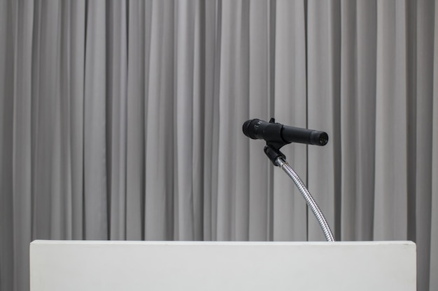 Microphone placed on the table in the meeting room with copy space