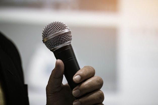 Microphone of speech in seminar room or speaking conference hall