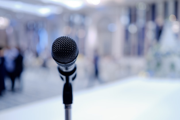 Microphone on stage, speaker, conference