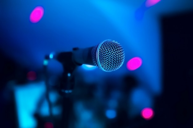 Microphone stands on stage in a nightclub. bright