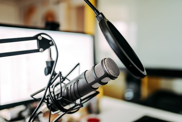 Microphone and white computer screen