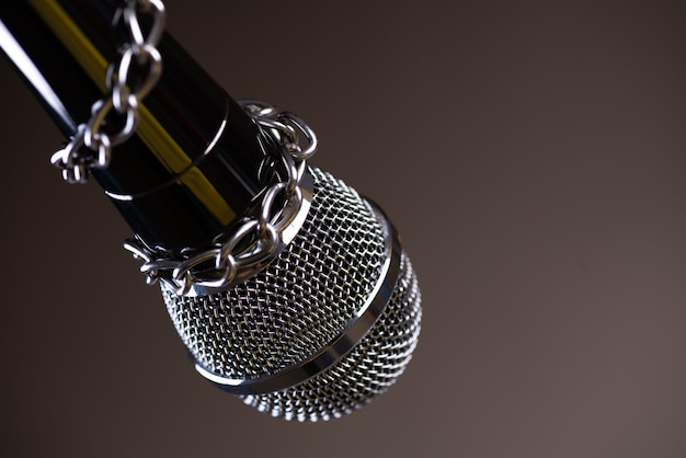 Microphone with a chain, the idea of press freedom concept.