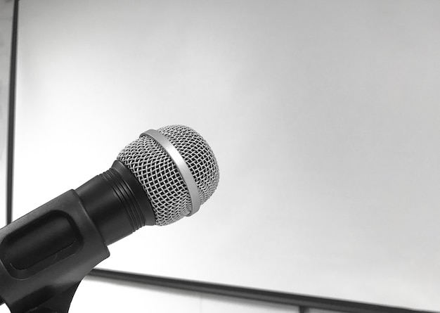A microphone with empty screen board wall