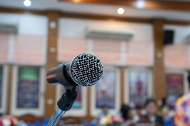 Microphones on blurred of speech in meeting room, front in university hall