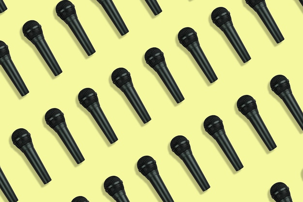 Microphones pattern on yellow background