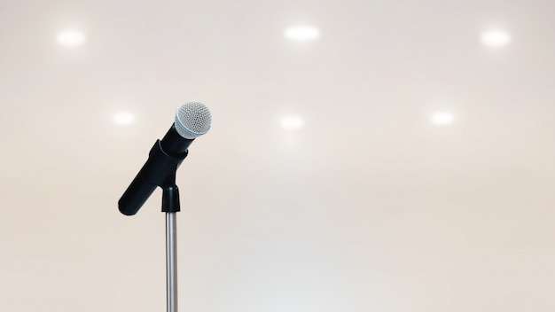 The microphones on the stand for public speaking.